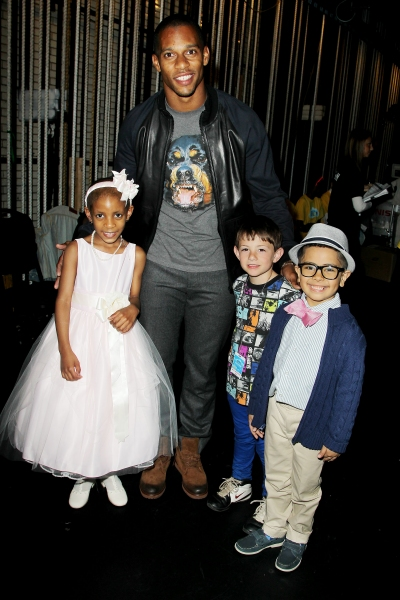 Performer Julianna Pierre of Maria Fareri Childrenâ€s Hospital with NY Giants wide receiver Victor Cruz and fellow performers Nicholas Anderson and Malik Naser of Make-a-Wish Foundation of New Jersey