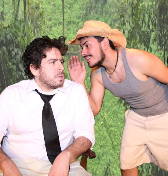 Shannon (Scott McWirter) listens terrified as Pancho (Jose Rivera) is glad to whisper in his ear all of the disgusting details.