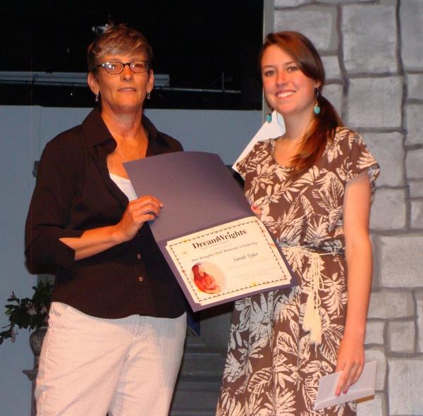 Ann Davis, executive director presents award to Sarah Tyler