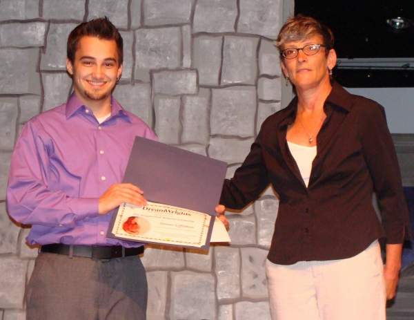 Tanner Uffelman receives award form Ann Davis, executive director
