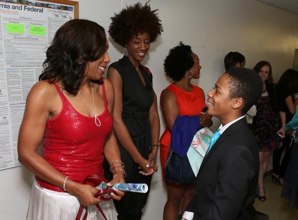 Actress Dawnn Lewis and cast member Deandre Sevon talk backstage Photo