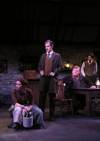 Izzie Steele as Pegeen, Matt Sullivan as Michael James Flaherty, Michael Daly as Jimmy Farrell and James Russell as Shawn Keogh gather in the country public-house.