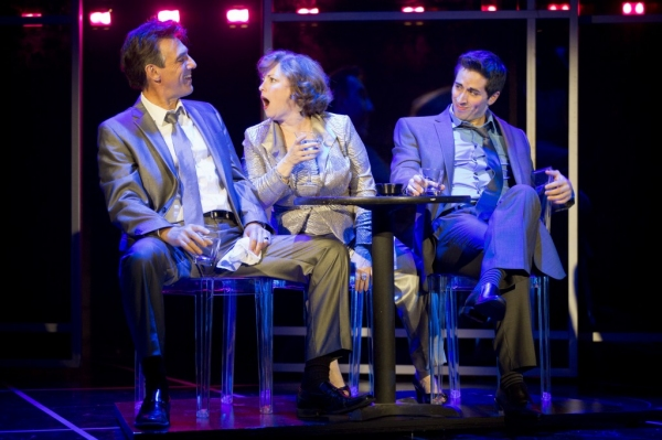 Joanne (Sherri L. Edelen; center) gets fired up to sing 'The Ladies Who Lunch' while out on the town with Larry (Thomas Adrian Simpson; left) and Bobby (Matthew Scott; right).