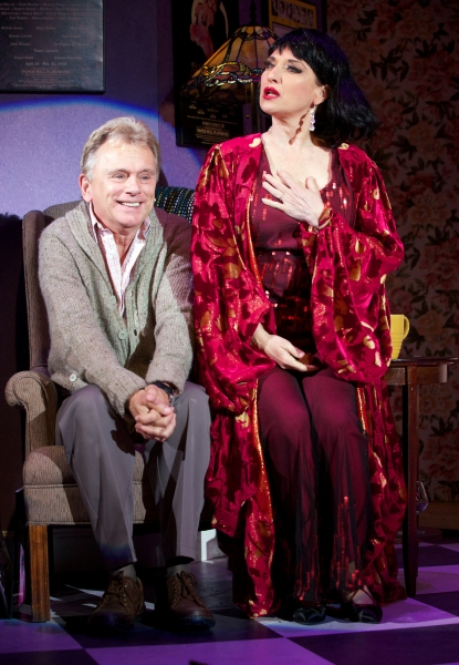 Pat Sajak as the Man in the Chair, alongside Liz Larsen, as the Drowsy Chaperone Photo