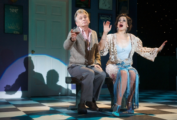Pat Sajak as the Man in the Chair, alongside Courtney Romano, as Janet Photo