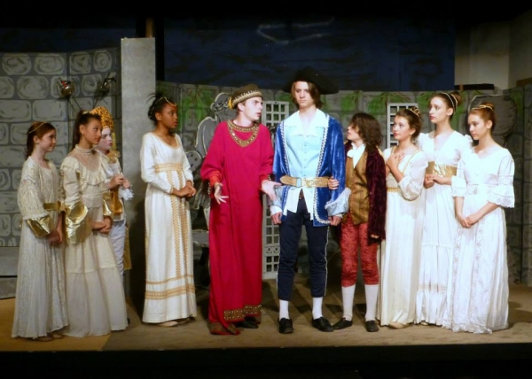 Canard (Trevor Hart, in red), King Confort (Osric Holt) and Ladies in Waiting (from left Melana Dix, Tyler Cable, TaiJonna Boone, HanaLina Woolley, Avalon Silver, and Emilia Zielinski) do their best to keep Paysanne (Anthony Olivas, center) from leaving t