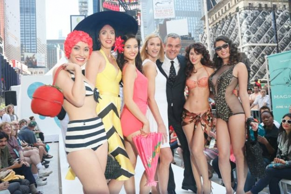 "Miami Beach invades Times Square! On Wednesday, June 12th the popular Starz drama, �""Magic City,"" transformed Times Square into 1959 Miami Beach, complete with bathing beauties, cabana boys and a vintage car. Stars of the hit series, Kelly Lync"