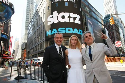 "After ringing the NASDAQ Opening Bell on Wednesday, June 12th to celebrate the season two premiere of ""Magic City"" (Friday, June 14th), cast members Danny Huston and Kelly Lynch joined show creator Mitch Glazer for a photo in the middle of Times Squar"