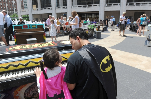 Warren Alvarez and his daughter Delilah, 5, of Queens, enjoy Father''s Day by playing one of the 88 Sing for Hope Pianos