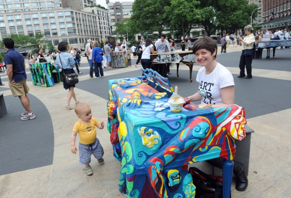 Artist Jessica Browne-White plays the piano she designed, one of the 88 Sing for Hope Pianos