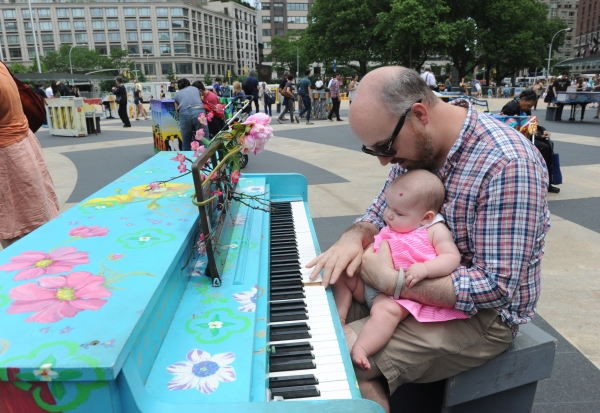 Seth Johnson and his daughter Phoebe, enjoy Father''s Day by playing one of the 88 Sing for Hope Pianos