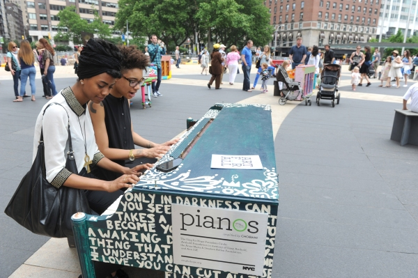 Jay Williams and Lee Bullitt, of New York, play on the piano designed by Arianna Huffington and her sister Agapi Stassinopoulos, one of the 88 Sing for Hope Pianos, supported by Chobani, Inc., at the Josie Robertson Plaza at Lincoln Center, Sunday, June 1