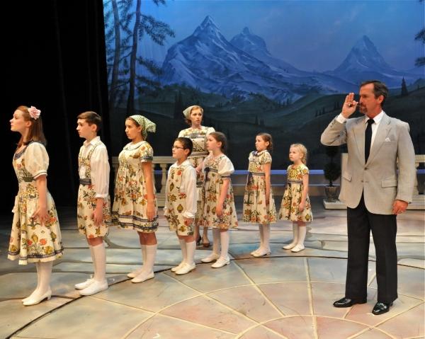 The Captain (Matthew Shepard) with the von Trapp Children and Maria (Aubrey Sinn)