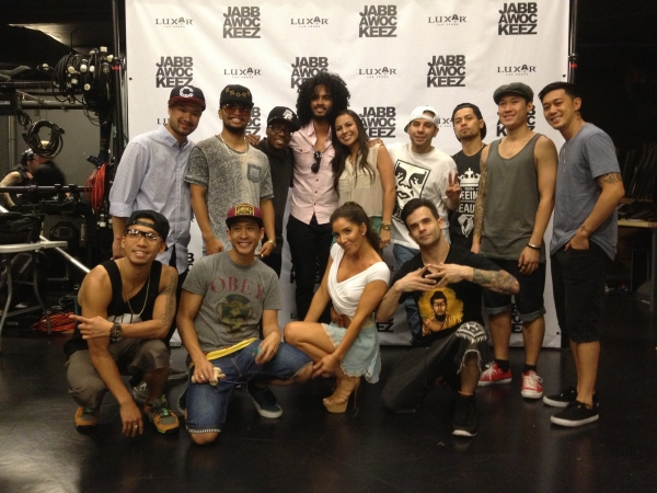Comedian Anjelah Johnson backstage with the Jabbawockeez cast
