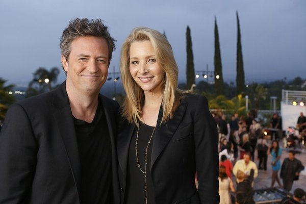 HOLLYWOOD GAME NIGHT -- Episode 104 -- Pictured: (l-r) Matthew Perry, Lisa Kudrow-- (Photo by: Trae Patton/NBC)