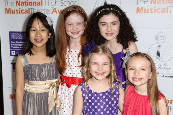 Lilla Crawford with the cast of ''Annie