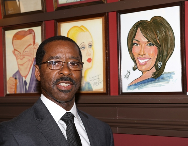 Courtney B. Vance, pictured next to a caricature of wife Angela Bassett