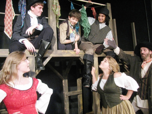 Fagin (DeLarme Landes, far right) introduces Oliver (Adam Juraga, center) to Nancy (T Photo