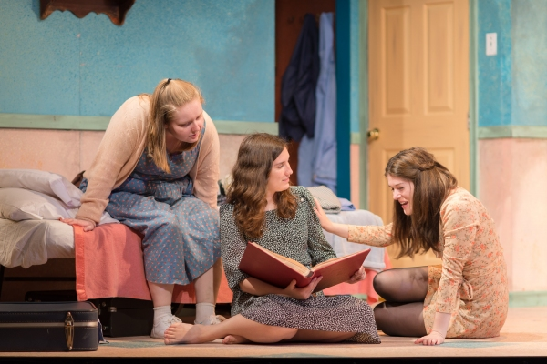 The Magrath sisters (from left to right, Maeve Brady, Holly Linneman, and Sarah Paton) reminisce over an old photo album in Crimes of the Heart.