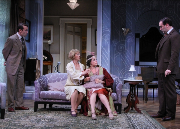 Ned Noyes as Willy Banbury (left) and Jeffrey M. Bender as Fred Sterroll (right) confront their wives, played by Julie Jesneck as Julia Sterroll (center left) and Melissa Miller as Jane Banbury, about their strange behavior.