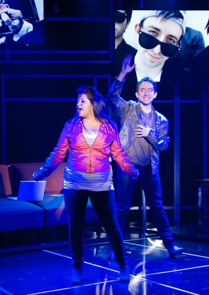 Makalo (Carolyn Cole) and Evan (James Gardiner) rehearse a song for national television