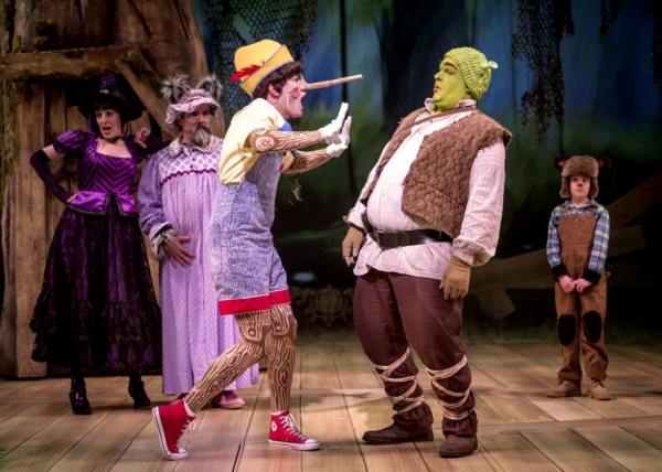 Sarah Page as the Witch, Norm Boucher as the Wolf, Adam Fane as Pinocchio, Michael Aaron Lindner as Shrek, and Cameron Conforti as Baby Bear i