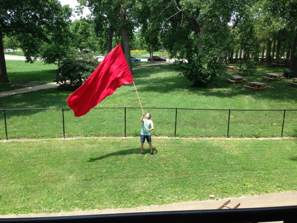 Duke Anderson practicing waving the flag for
