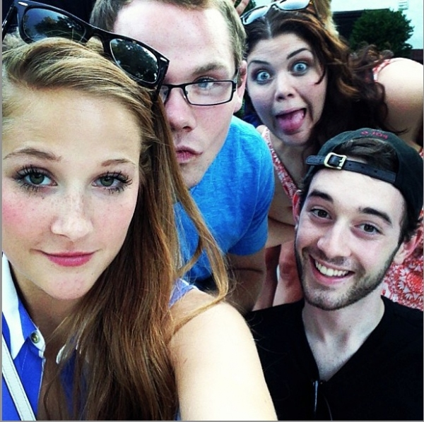 Tiffany Green photo bombing Lindsey Mader, Julien Decker and Connor Deane's selfie.