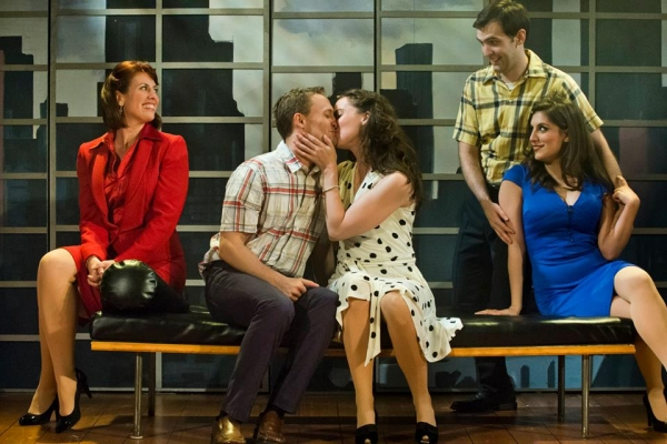 The group joyfully looks on as Frank (Danny Gardner) and Abby (Patricia Noonan) share a sweet kiss