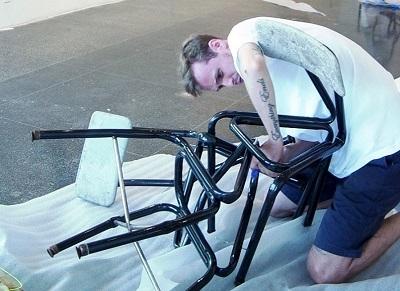 Brooklyn artist Evan Robarts installing his artwork
