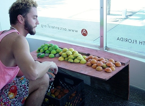 Miami artist Johnny Laderer installing his artwork