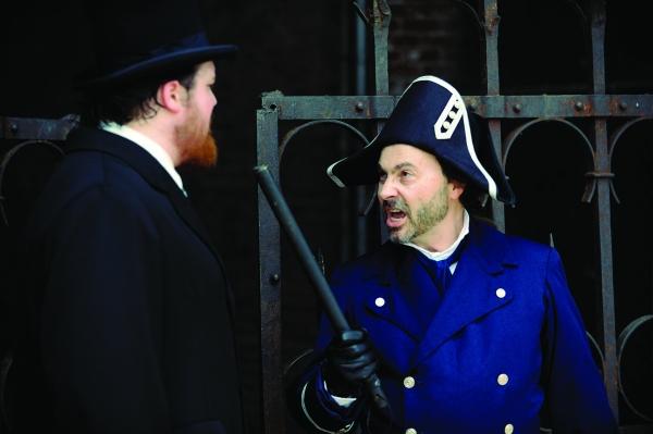 Phillip Andrew Himebrook as Valjean & Michael Detroit as Javert Photo