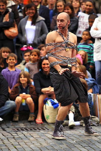 From the United Kingdom comes Rob Roy Collins, an impressive comedic escape artist and acrobat who literally finishes his show on a high as he escapes from 20 metres of steel chain and handcuffs on top of a 12-foot ladder!