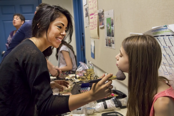 Estee Lauder makeup artist Priscilla Freire makes up a student