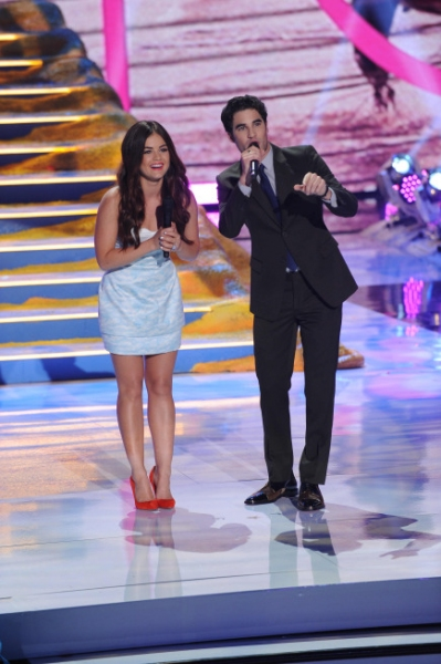 TEEN CHOICE 2013: Co-hosts Lucy Hale and Darren Criss during TEEN CHOICE 2013, airing LIVE Sunday, Aug. 11 (8:00-10:00 PM ET live/PT tape-delayed) on FOX at Gibson Amphitheater, Universal City, CA.  CR: Ray Mickshaw/FOX