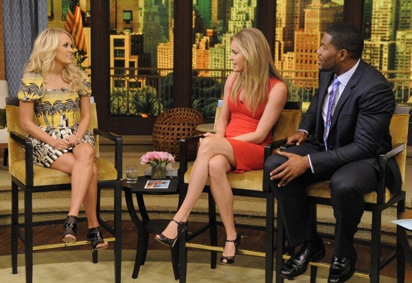 LIVE WITH KELLY AND MICHAEL -8/13/13 - Carrie Underwood is a guest on ''LIVE with Kelly and Michael,'' distributed by Disney-ABC Domestic Television. (Disney-ABC/ Lorenzo Bevilaqua)CARRIE UNDERWOOD, REBECCA ROMIJN, MICHAEL STRAHAN