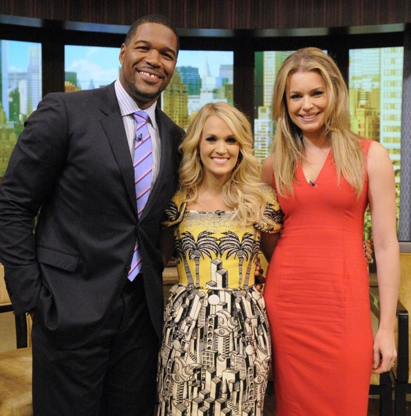 LIVE WITH KELLY AND MICHAEL -8/13/13 - Carrie Underwood is a guest on ''LIVE with Kelly and Michael,'' distributed by Disney-ABC Domestic Television. (Disney-ABC/ Lorenzo Bevilaqua)MICHAEL STRAHAN, CARRIE UNDERWOOD, REBECCA ROMIJN