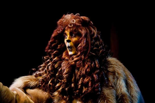 Seth Caikowski as The Cowardly Lion