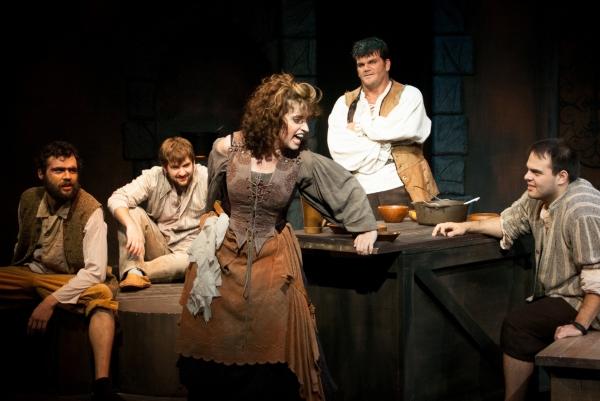 Boni Hester (Center) as Aldonza and (from left) Stephen Mercantel, Paul Koudouris, Br Photo