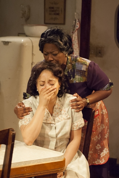 Lena ''Mama'' Younger (Greta Oglesby, right) comforts Ruth Younger (Toni Martin, left).