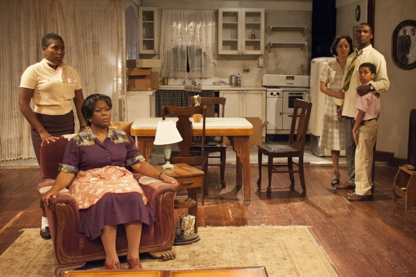 The Younger family: Beneatha (Mildred Marie Langford, from left), Lena (Greta Oglesby), Ruth (Toni Martin), Walter Lee (Jerod Haynes) and Travis (Oscar Vasquez III, pictured, who alternates the role with Alex Henderson).