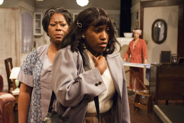 Lena ''Mama'' Younger (Greta Oglesby, left) has a strong reaction to her daughter Beneatha''s (Mildred Marie Langford, center) beliefs, with Ruth Younger (Toni Martin) in the background.