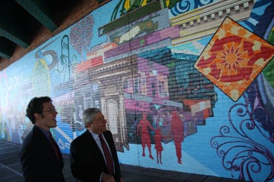 Brooklyn Borough President Marty Markowitz joins Atlantic Avenue BID Executive Director Josef Szende in touring a new mural, painted by artists and student volunteers from Groundswell, which he helped unveil in the underpass of the Brooklyn-Queens Express