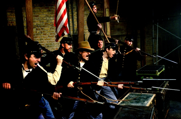 (Top) Michael McKeogh as Colonel Joshua Lawrence Chamberlain and (bottom, L to R) Matt Fletcher, Sean Sinitski, Tom Hickey, Niall McGinty, Zach Livingston, and Joe Flynn as Union soldiers