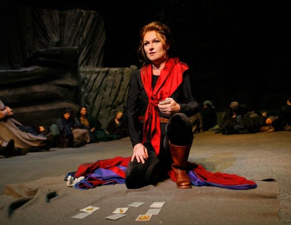 Carmen (Patricia Bardon) predicts her own death when she tells her fortune.