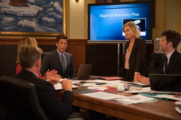 PARKS AND RECREATION -- ''The Pawnee-Eagleton Tip Off Classic'' Episode 603 -- Pictured: (l-r) Rob Lowe as Chris Traeger, Amy Poehler as Leslie Knope, Adam Scott as Ben Wyatt -- (Photo by: Colleen Hayes/NBC)
