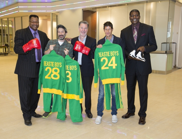 Adam Horovitz and Mike D of the Beastie Boys, former heavyweight champ Larry Holmes and former NY Knick Larry Johnson present Hank Ratner, President of The Madison Square Garden Company, with personal memorabilia for display in the new Signature Suites at