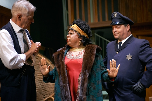 Ma Rainey (Tina Fabrique*) sets the record straight for her manager, Sturdyvant (Tom Bloom*)  as police officer (Corey Gagne) looks on