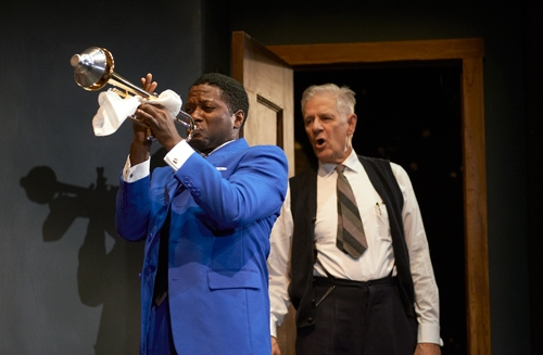 Levee (Warner Miller*) soulfully plays his trumpet just as Irvin (Tom Bloom*) interrupts the band's rehearsal