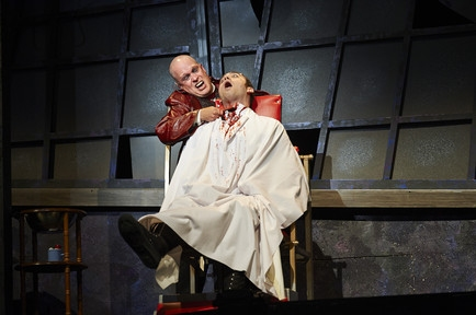 Actor Tom Ford (left, as Sweeney Todd) dispatches another victim, actor Alex Syiek (right)